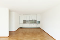 Empty living room with kitchen Royalty Free Stock Images