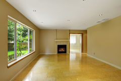 Empty living room with shiny marble tile floor Royalty Free Stock Photo
