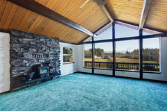 Empty living room with turquoise carpet floor in luxury house. Stock Photo