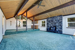 Empty living room with turquoise carpet floor in luxury house. Royalty Free Stock Photos