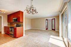 Empty living room. View of kitchen cabinets Royalty Free Stock Photography