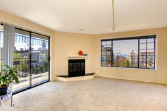 Empty living room with walkout deck Stock Photos