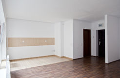 Empty living in studio-type apartment Stock Photos