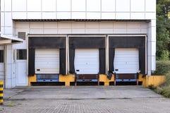 Empty loading dock abandoned. Three doors on a empty loading dock abandoned Stock Image