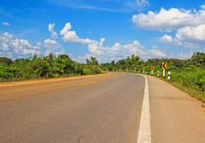 Empty local road and blue sky with clouds Royalty Free Stock Photography