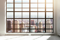 Empty loft interior with city view Stock Photos
