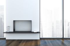 Empty loft living room, white fireplace. Empty loft living room interior with a wooden floor a white fireplace and a modern cityscape in the window. 3d rendering Stock Images
