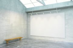 Empty loft room with big blank white poster on the wall and wood Stock Photo