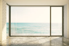 Empty loft room with big window in floor and ocean view Stock Image