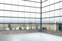 Empty loft room with windows in floor and city view Stock Photo