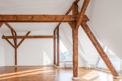 Empty loft room with wooden framework and parquet floor.  Stock Images