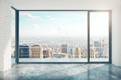 Empty loft style room with concrete floor and city view Stock Images