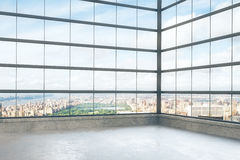 Empty loft style room with glassy windows and city view Stock Photos