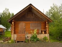 A closed up cottage beside the yukon river at eagle royalty free stock image