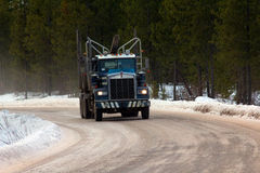 Empty Logging Truck Heading for more Logs Stock Photos