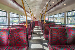 Empty London bus interior. Empty seats on an upper level of a London double decker bus Royalty Free Stock Photography