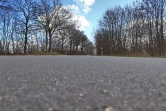 Empty and lonely country roads found in northern germany stock photography