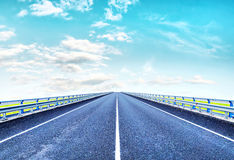 Empty lonely highway goes to horizon Royalty Free Stock Photos