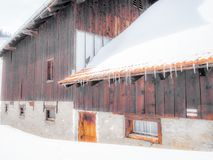 An empty and lonely stable and chalet in the Swiss Alps - 6 Stock Image