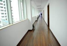 Empty long corridor. With lots of windows Stock Image