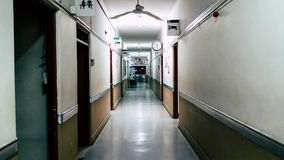 Empty long corridor in the hospital, at the end of the corridor you can read that it says: surgical center royalty free stock images