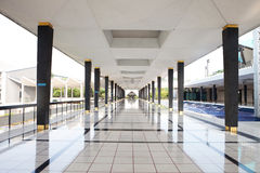 Empty long corridor in the modern building. Royalty Free Stock Images