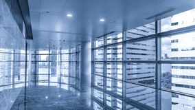 Corridor of modern commercial building. Empty long corridor in the modern commercial building royalty free stock images