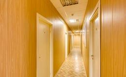 Empty long corridor Stock Photos
