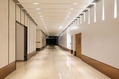 Corridor of modern  building. Empty long corridor in the modern office building royalty free stock image