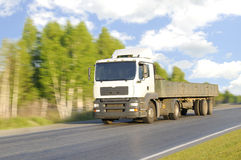 Empty lorry. The empty lorry quickly rushes on highway, on a background of the beautiful nature Stock Photos