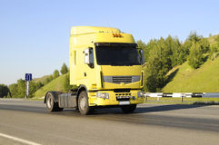 Empty lorry. The empty lorry, Yellow,  quickly rushes on highway, on a background of the beautiful nature Stock Image