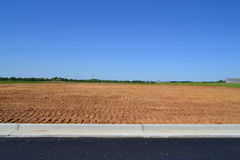 Empty Lot in a Newly Built Neighborhood Development Stock Photography