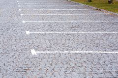 Empty lot parking for cars. Empty parking for cars with free lots outdoors in the park area of the city, close up side view royalty free stock photography