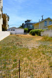 Empty lot. An empty or vacant lot between two properties Stock Photo