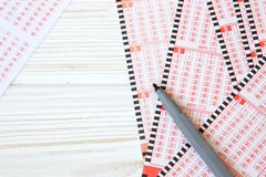 Empty lotto tickets. On wooden table stock photo