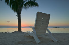 Empty Lounge Chair on the Beach Royalty Free Stock Images