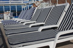 Empty lounge chair on the cruise ship. Empty lounge chairs on the cruise ship on sunny day Stock Image