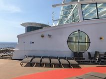 Lounge chairs on a cruise ship deck. Empty lounge chairs on a cruise ship deck on the Celebrity Cruise ship Summit royalty free stock photo