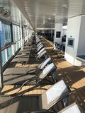 Lounge chairs on a cruise ship deck. Empty lounge chairs on a cruise ship deck on the Celebrity Cruise ship Summit stock image