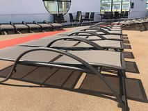 Lounge chairs on a cruise ship deck. Empty lounge chairs on a cruise ship deck on the Celebrity Cruise ship Summit royalty free stock image