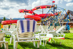 Empty Lounger And Water Slide In Aquapark Royalty Free Stock Photos