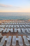 Empty loungers at the beach. Lot of deck-chairs at the beach of city of Nice, France, Cote d'Azur Stock Photo