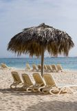 Empty loungers on a tropical b. Each with sunshade (Punta Cana, Dominican Republic stock images