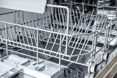 Empty lower basket in the dishwasher. Close up photo Stock Photography