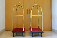 Empty luggage carts. Two empty luggage carts in a hotel hallway. Hospitality industry  background Royalty Free Stock Photography