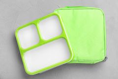 Empty lunch box and bag on table. Top view stock photography