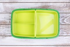 Empty lunch box on wooden table, top view stock photography