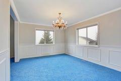Empty luxury room interior with blue carpet floor and chandelier Stock Photo