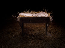 Empty manger at night. Empty manger in the straw at night royalty free stock images