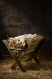 Empty Manger in Stable. Manger filled with hay in stable with baby soft cloths on top Stock Photos